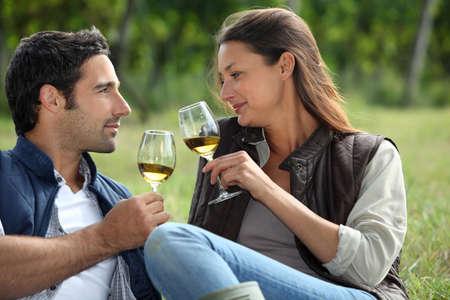 taste: Couple sampling wine whilst visiting vineyard Stock Photo