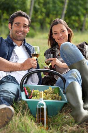Grapepickers enjoying a glass of wine photo
