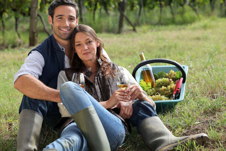 Couple having a picnic in a vineyard photo