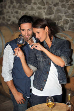 portrait of a couple tasting wine photo