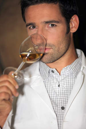 man tasting wine photo