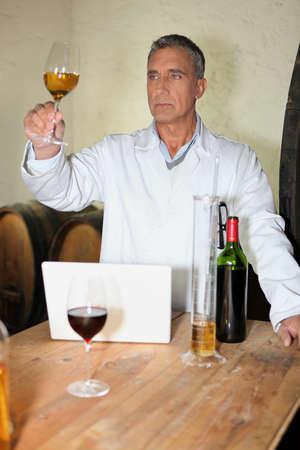 probe: Winemaker analyzing wine