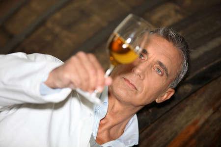 olfaction: Man tasting wine
