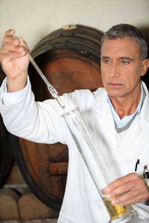 Man testing brandy in a cellar Stock Photo - 13767261