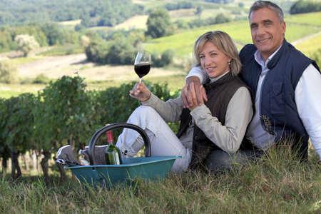 terroir: Couple tasting wine in a vineyard Stock Photo