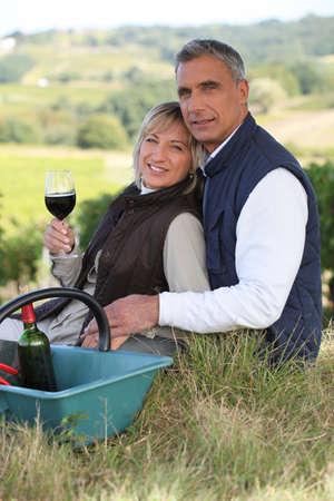 wine grower: Couple tasting wine in a vineyard Stock Photo