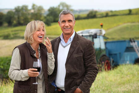 wine grower: wine producers laughing in the vines