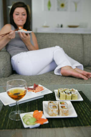 a woman eating sushi photo