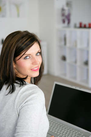 Brunette sat with her portable computer Stock Photo - 13767091