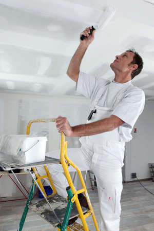 stucco facade: craftsman painting the ceiling