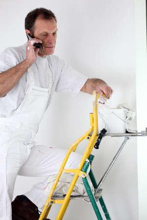 Painter making a phone call photo
