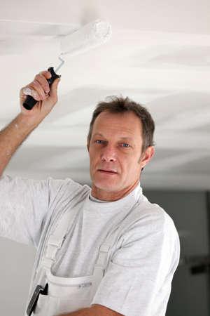 paintcan: Decorator painting ceiling
