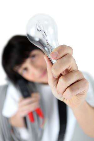craftswoman: craftswoman holding a bulb Stock Photo