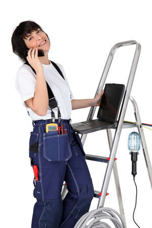 a female technician at phone Stock Photo - 13778399