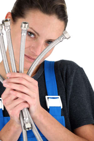 braided flexible: Female plumber with flexible hoses