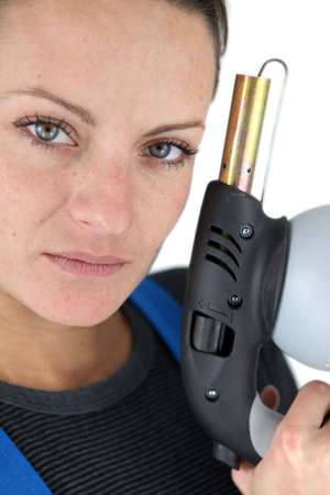 Woman holding a blowtorch photo