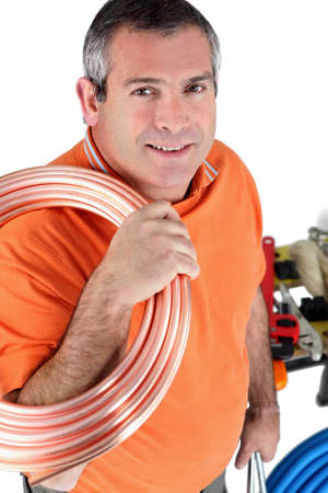 Workers with shoulder roll tube Stock Photo - 13779649