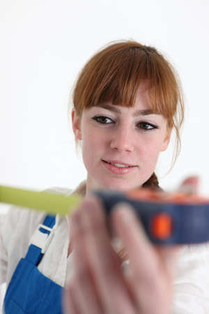 Woman using a measuring tape photo