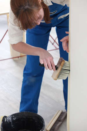 Woman using a wallpaper brush photo