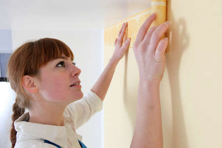 redecorating: Woman redecorating her home