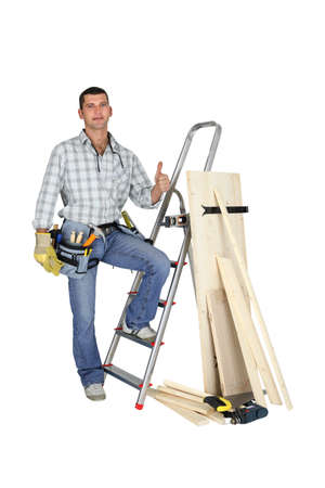 reforming: Thumbs up from a carpenter Stock Photo