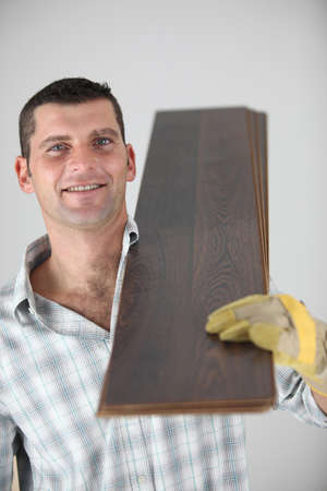 craftsman carrying wooden boards Stock Photo - 13780619
