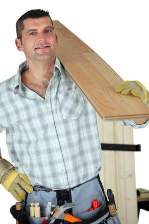 woodworker: Handyman holding plank