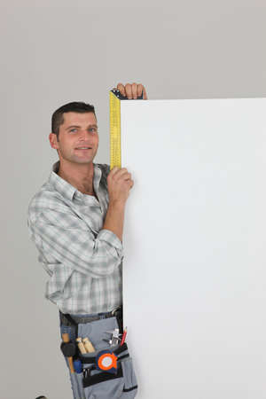 Manual worker stood with blank panel Stock Photo - 13780544