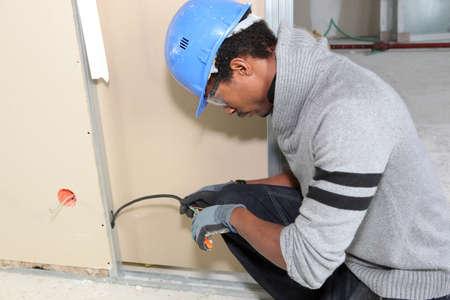 electrics: Man working on houses electrics