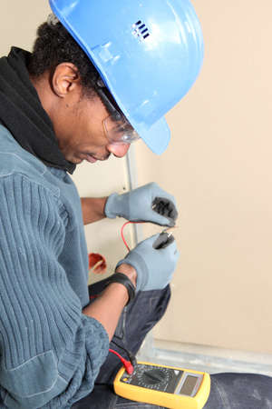 Electrician using voltmeter Stock Photo - 13780433