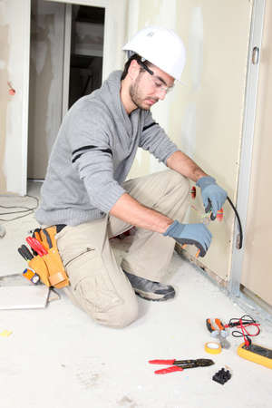 Electrician wiring a house photo
