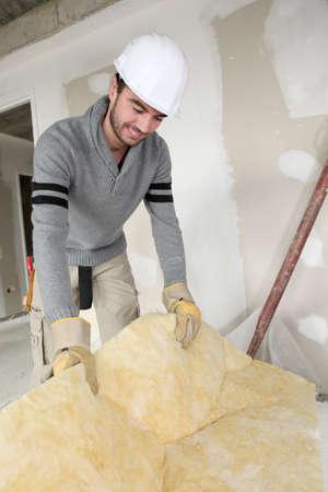 rockwool: Builder insulating house Stock Photo