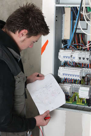 electrical panel: Electrician with sketch of electrical panel