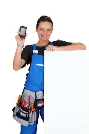 toolbelt: Woman with blank board, toolbelt and cellphone