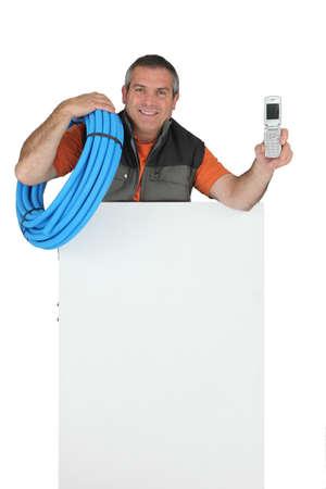 Foreman with mobile phone, studio shot photo