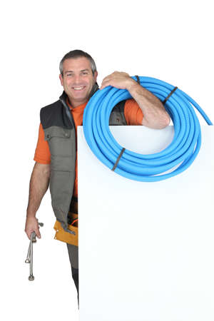 flexi: Smiling man with blank board and blue tube