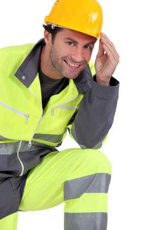 the unskilled worker: Traffic guard wearing hard hat