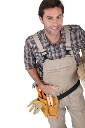 Builder smiling with tools. photo