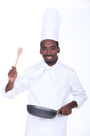 Chef with a pan and wooden spoon Stock Photo - 13779161