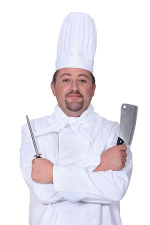 stirring: Chef holding meat cleaver and knife sharpener