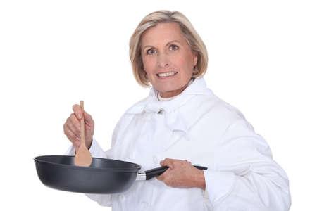 epicurean: Woman stirring sauce