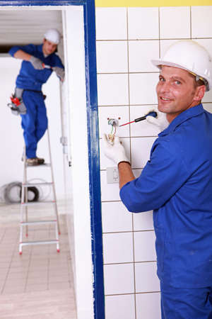 duo: duo of electricians indoors Stock Photo