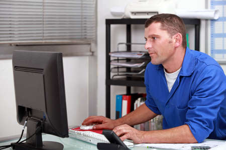 web side: A builder working in the office