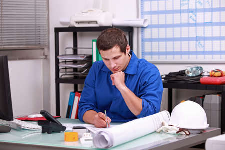 tradesmen: Manual worker completing paperwork Stock Photo