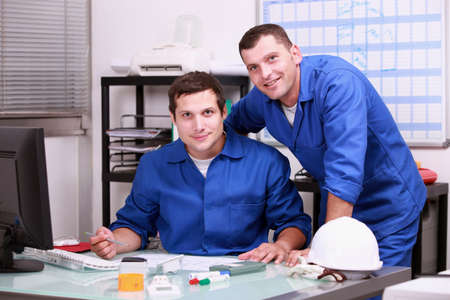 jumpsuite: two technicians working in office Stock Photo