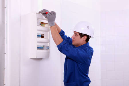 electrician working on the fuse board photo