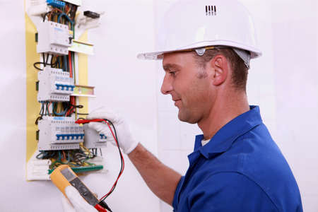 electrical panel: electrician measuring voltage