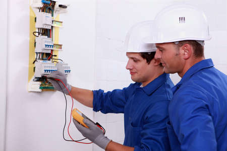 Two electricians performing checks photo