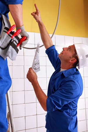 Men inspecting electrical installations Stock Photo - 13782857