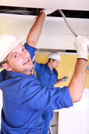 ceiling plate: Electricians working on roof